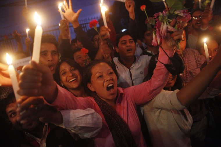 Students affiliated with Communist Party of Nepal (Unified Marxist–Leninist) light candles to celebrate Nepal's new constitution in Kathmandu, Nepal, Thursday, Sept. 17, 2015. Nepal's Constituent Assembly overwhelmingly approved a new national constitution on Wednesday that had been delayed for years because of differences between the main political parties. (AP Photo/Niranjan Shrestha)