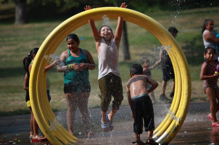 Erick Montiel, 7, cools off at Third Ward Park in Passaic, N.J., on Wednesday, Sept. 2, 2015. Temperatures climbed into the 90's Wednesday and the heat is expected to continue Thursday. (Kevin R. Wexler/The Record of Bergen County via AP)