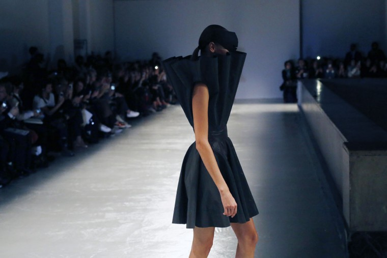 A model wears a creation by Japanese designer Kunihiko Morinaga for his brand Anrealage as part of his Spring-Summer 2016 ready-to-wear fashion collection, presented during the Paris Fashion Week in Paris, France, Tuesday, Sept.29, 2015. (AP Photo/Jerome Delay)