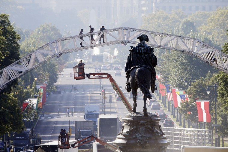 Workers build a stage ahead of Pope Francis' scheduled visit, Thursday, Sept. 17, 2015, on Eakins Oval in view of a statue of George Washington, in Philadelphia. (AP Photo/Matt Rourke)