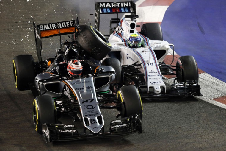 Force India driver Nico Hulkenberg of Germany, left, collides with Williams driver Felipe Massa of Brazil during the Singapore Formula One Grand Prix on the Marina Bay City Circuit in Singapore, Sunday, Sept. 20, 2015.(AP Photo/Ng Han Guan)