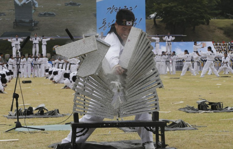 A soldier from the South Korean army special forces breaks stone plates with his hand during a rehearsal for the 67th anniversary of Armed Forces Day at the Gyeryong military headquarters in Gyeryong, South Korea, Wednesday, Sept. 30, 2015. South Korea will celebrate the 67th Armed Forces Day on Oct. 1. (AP Photo/Ahn Young-joon)