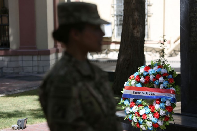 A NATO service member takes part in a memorial ceremony on the fourteenth anniversary of the 9-11 terrorist attacks on the United States at the headquarters of the International Security Assistance Force, in Kabul, Afghanistan, Friday, Sept. 11, 2015. (AP Photo/Rahmat Gul)