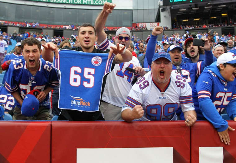 Buffalo Bills fans cheer before an NFL football game against the Indianapolis Colts on Sunday, Sept. 13, 2015, in Orchard Park, N.Y. (Bill Wippert/AP photo)