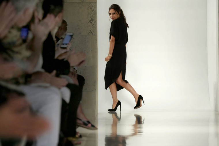 Designer Victoria Beckham acknowledges audience applause after her Spring 2016 collection was modeled during Fashion Week in New York, Sunday, Sept. 13, 2015. (AP Photo/Richard Drew)