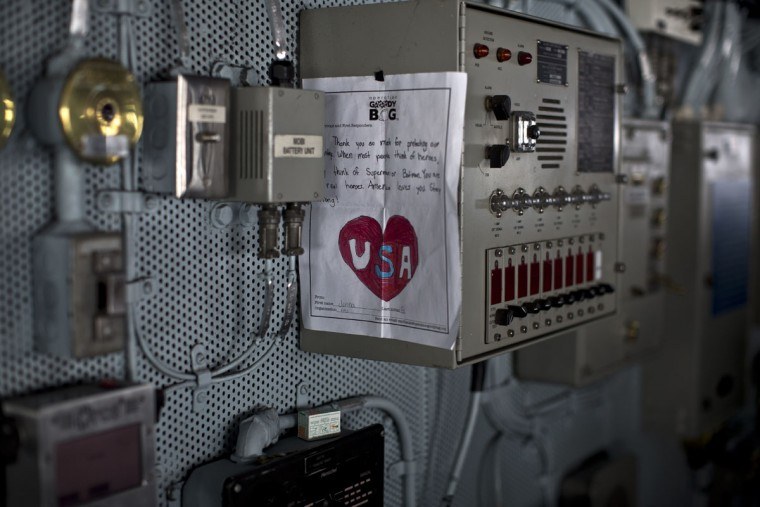 A letter of support to members of the U.S. military received in a care package is hanged inside the Pilot Bridge on board the USS Theodore Roosevelt currently deployed in the Persian Gulf. Pilots onboard have flown missions into both Iraq and Syria, part of the over 6,800 airstrikes carried out by the coalition since August 2014. Some 20 percent of all coalition strikes come from aircraft launched from the nuclear-powered Roosevelt.(AP Photo/Marko Drobnjakovic)