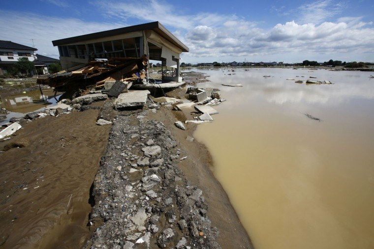 A house is damaged after floods hit Joso, Ibaraki prefecture, northeast of Tokyo, Friday, Sept. 11, 2015. The sun came out a day after a raging river washed away houses and forced people to rooftops as dozens of residents were airlifted out by military helicopters Friday morning after waiting overnight in the city. (AP Photo/Shizuo Kambayashi)