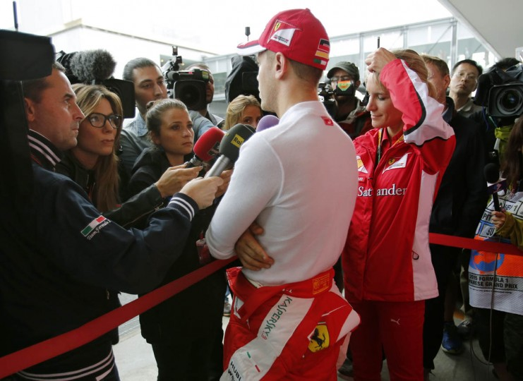 Ferrari driver Sebastian Vettel of Germany speaks to the media after the second practice session for the Japanese Formula One Grand Prix at the Suzuka Circuit in Suzuka, central Japan, Friday, Sept. 25, 2015. (Shizuo Kambayashi/AP photo)