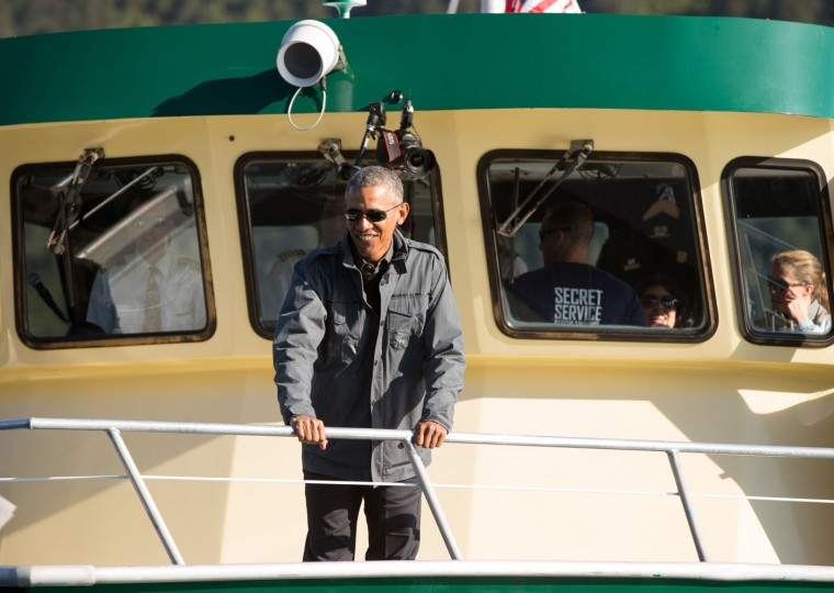 President Barack Obama stops at Thumb Cove while taking a boat tour to see the effects of global warming in Resurrection Cove, Tuesday, Sept. 1, 2015, in Seward, Alaska. Obama is on a historic three-day trip to Alaska aimed at showing solidarity with a state often overlooked by Washington, while using its glorious but changing landscape as an urgent call to action on climate change. (AP Photo/Andrew Harnik)