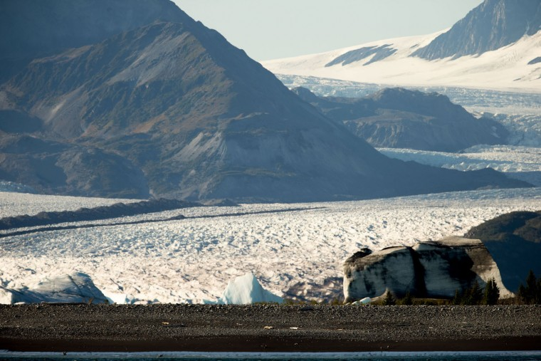 Bear Glacier, which has receded 1.8 miles in approximately 100 years, is visible as President Barack Obama goes on a boat tour to see the effects of global warming in Resurrection Cove, Tuesday, Sept. 1, 2015, in Seward, Alaska. Obama is on a historic three-day trip to Alaska aimed at showing solidarity with a state often overlooked by Washington, while using its glorious but changing landscape as an urgent call to action on climate change. (AP Photo/Andrew Harnik)