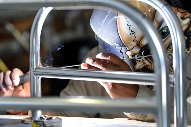Jose Juarez, of Cougar Marine in San Benito, Texas, welds anodized aluminum on Monday, Sept. 28, 2015. (Jason Hoekema/Valley Morning Star via AP)
