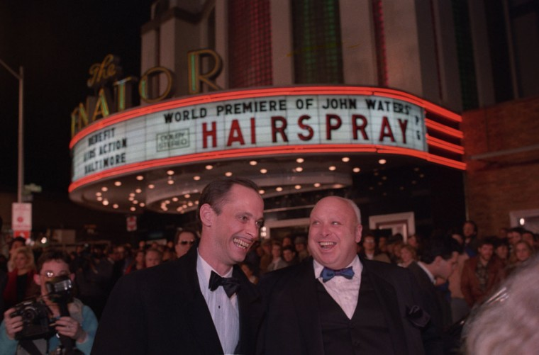 """February 16, 1988 - Baltimore director John Waters and drag queen Divine, aka Harris Glenn Milstead, share a light moment outside the Senator Theatre at the world premiere of """"Hairspray."""" (Amy Davis/Baltimore Sun)"""