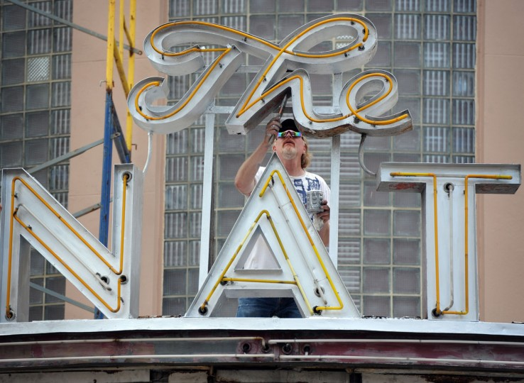 """Joe Belsinger, Belsinger Sign Works, Inc., paints a portion of """"The Senator"""" sign on the historic York Road theatre. In addition to painting, the company will install lighted panels on the marquee. (Kim Hairston/Baltimore Sun)"""