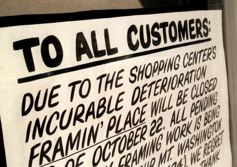"""2000 - Residents in Northeast Baltimore are looking at the status of the troubled Belvedere Square shopping center, and recent actions by the city to bring in a new owner. The north building of Belvedere Square has many vacancies, including the space formerly occupied by """"Framin' Place,"""" which has a sign in its window, announcing its closure due to the """"shopping center's incurable"""" deterioration. (Amy Davis/Baltimore Sun)"""