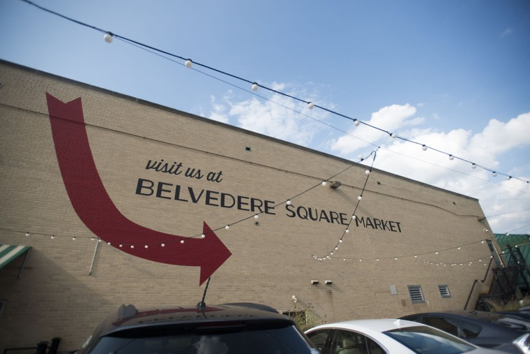 """""""Visit us at Belvedere Square Market"""" is painted on a building right around the corner. (Emma Patti Harris/Baltimore Sun)"""