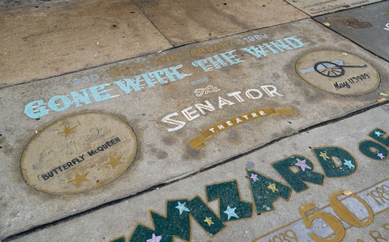 """The sidewalk in front of The Senator features a """"walk of fame"""" which highlights local cinematic accomplishments. (Emma Patti Harris/Baltimore Sun)"""