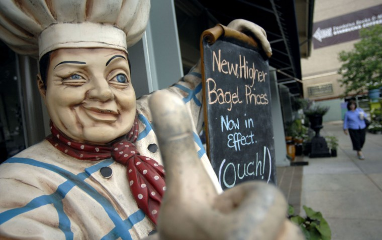 2008 - A statue of a chef holds a sign alerting customers of higher prices at Greg's Bagels in Belvedere Square shopping center. Due to inflation in fuel and food costs, many restaurants have reluctantly been forced to pass the increased price of doing business on to customers. (Glenn Fawcett/Baltimore Sun)