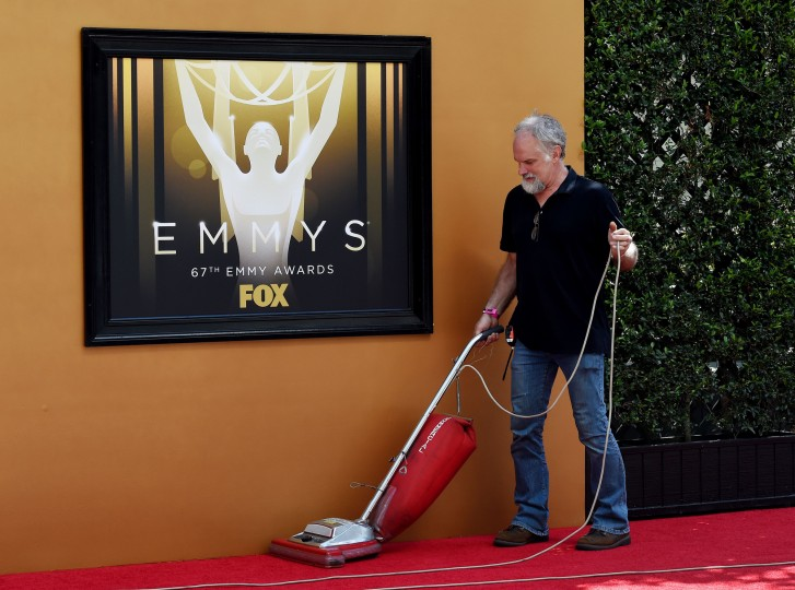 A worker cleans a section of red carpet on the eve of the 67th annual Primetime Emmy Awards, in downtown Los Angeles, California, September 19, 2015. Actor Andy Samberg will host the Emmy Awards, the biggest honors in television, in Los Angeles on September 20, 2015. (Mark Ralston/AFP-Getty Images)