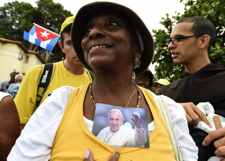 A woman holds a photo of Pope Francis during his visit in Havana on September 19, 2015, on the first leg of a high-profile trip that will also take him to the United States. (Luis Acosta/AFP-Getty Images)