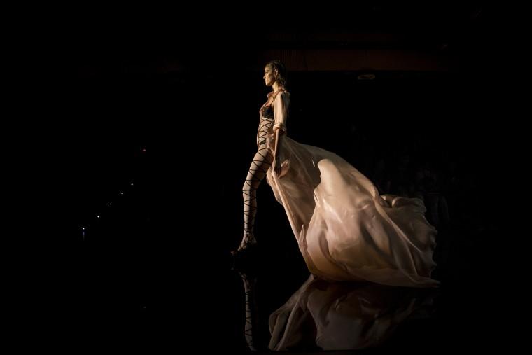 A model displays a 2016 Spring/Summer design by Andres Sarda at the Madrid's Fashion Week in Madrid, Spain, Saturday, Sept. 19, 2015. (Daniel Ochoa de Olza/Associated Press)