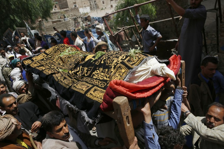 People carry a coffin of a man, who was killed in a Saudi-led airstrike during his funeral, in the Old City of Sanaa, Yemen, Saturday, Sept. 19, 2015. The overnight airstrikes against Yemen's Shiite rebels and their allies have killed almost 30 people, including civilians, in the capital Sanaa, security and medical officials there said Saturday. The coalition' airstrikes hit an apartment building in the center of the capital, a UNESCO world heritage site, killing a family of nine, the officials who remain neutral in the conflict that has divided Yemen's security forces said. (Hani Mohammed/Associated Press)