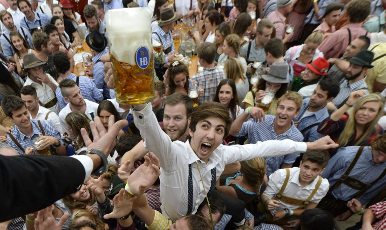 Visitors to the Oktoberfest beer festival get the first beers after the festival's opening in Munich, southern Germany, on September 19, 2015. The world biggest Beer festival Oktoberfest will start on September 19, 2015 and take place until October 4, 2015. (Christof Stache/AFP-Getty Images)