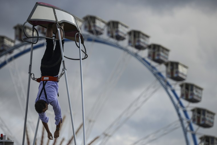 A reveler performs a looping in a swingboat on the opening day of the 2015 Oktoberfest on September 19, 2015 in Munich, Germany. The 182nd Oktoberfest will be open to the public from September 19 through October 4 and will draw millions of visitors from across the globe in the world's largest beer fest. (Philipp Guelland/Getty Images)
