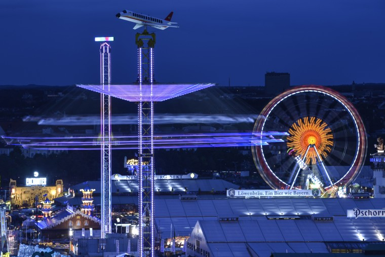 A long exposure taken at dawn shows illuminated tents and caroussels on the opening day of the 2015 Oktoberfest on September 19, 2015 in Munich, Germany. The 182nd Oktoberfest will be open to the public from September 19 through October 4 and will draw millions of visitors from across the globe in the world's largest beer fest. (Philipp Guelland/Getty Images)