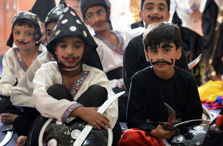 Indian school children, dressed as soldiers, wait to perform in a Janmashtami play at Delhi Public School in Ghaziabad, some 20 kms east of New Delhi on September 1, 2015. Janmashtami, which takes place this year on September 5, is an annual celebration of the birth of the Hindu deity Krishna. (PRAKASH SINGH/AFP/Getty Images)