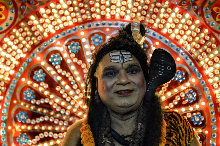 An Indian man dressed as the Hindu god Shiva looks on during a Janmashtami procession in New Delhi on September 1, 2015. Janmashtami, which takes place this year on September 5, is an annual celebration of the birth of the Hindu deity Krishna. (Chandan Khanna/AFP/Getty Images)