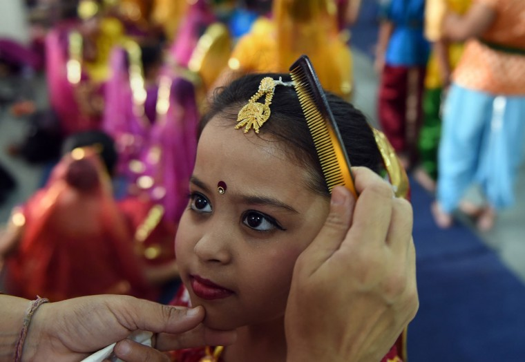An Indian schoolgirl has a last minute make-up check prior to performing in a Janmasthmi play at Delhi Public School in Ghaziabad, some 20 kms east of New Delhi on September 1, 2015. Janmashtami, which takes place this year on September 5, is an annual celebration of the birth of the Hindu deity Krishna. (PRAKASH SINGH/AFP/Getty Images)