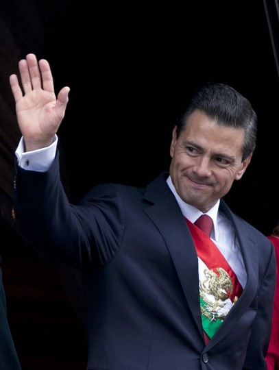 Mexico's President Enrique Pena Nieto salutes during the Independence Day military parade in the capital's main plaza, the Zocalo, in Mexico City, Wednesday, Sept. 16, 2015. Mexico celebrates the anniversary of its 1810 independence uprising. (AP Photo/Marco Ugarte)