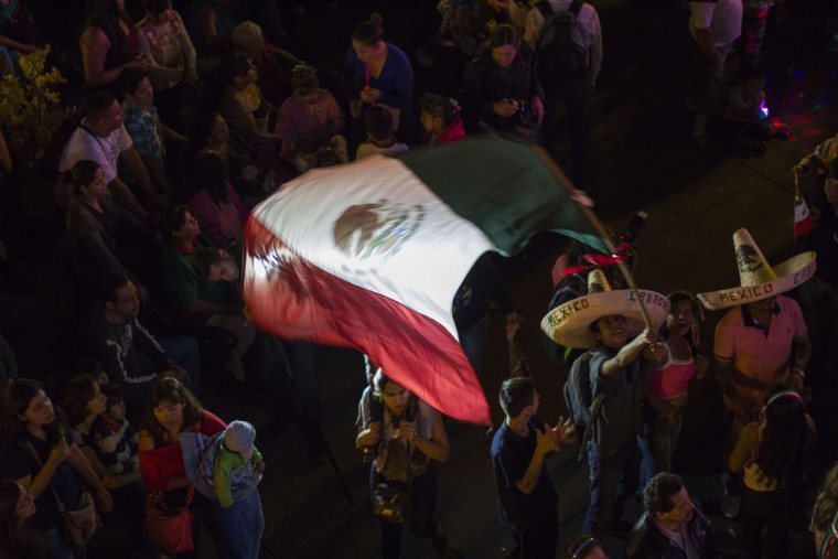 People celebrate during the 205th Mexico Independence Day celebrations at the Armas Square in Guadalajara City on September 15, 2015. (HECTOR GUERRERO/AFP/Getty Images)