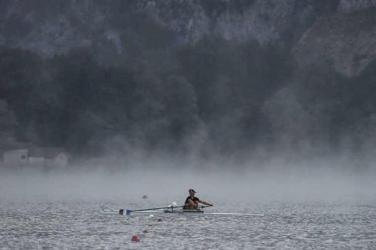 A rower warms up in the fog, on September 4, 2015 in Aiguebelette-Le-Lac, during the 2015 World Rowing Championships. (JEFF PACHOUD/AFP/Getty Images)