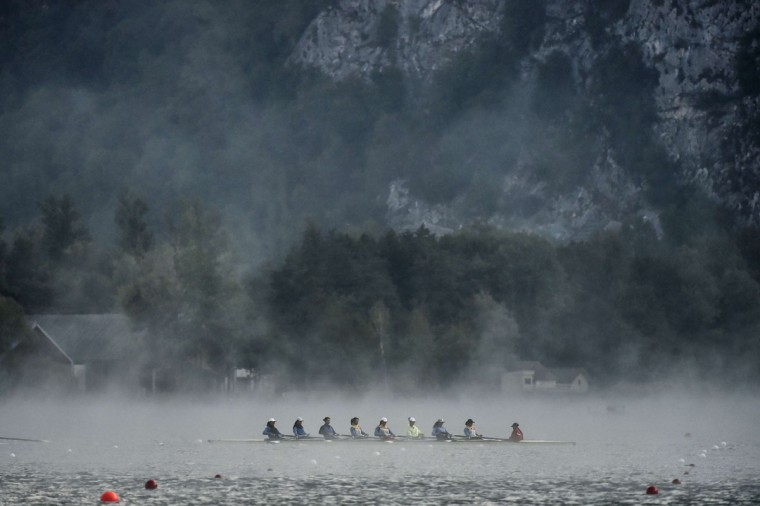 Rowers warm up in the fog on September 4, 2015 in Aiguebelette-Le-Lac, during the 2015 World Rowing Championships. (JEFF PACHOUD/AFP/Getty Images)