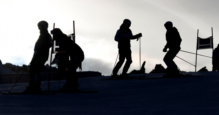 Athletes inspect the course prior to start an alpine ski, men's World Cup giant slalom, in Soelden, Austria, Sunday, Oct. 25 2015. (AP Photo/Giovanni Auletta)
