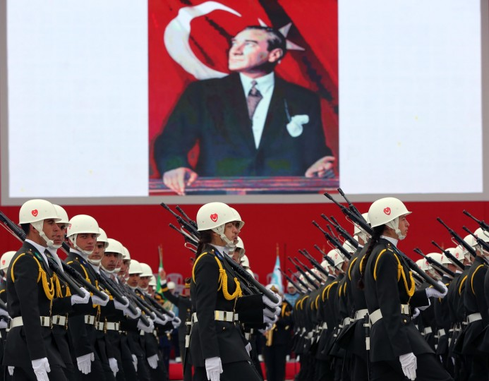 Turkish War Academy students parade during celebrations on Republic Day in Ankara, Turkey, Thursday, Oct. 29, 2015. An image of Turkey's founder Mustafa Kemal Ataturk is in the background. (AP Photo/Burhan Ozbilici)