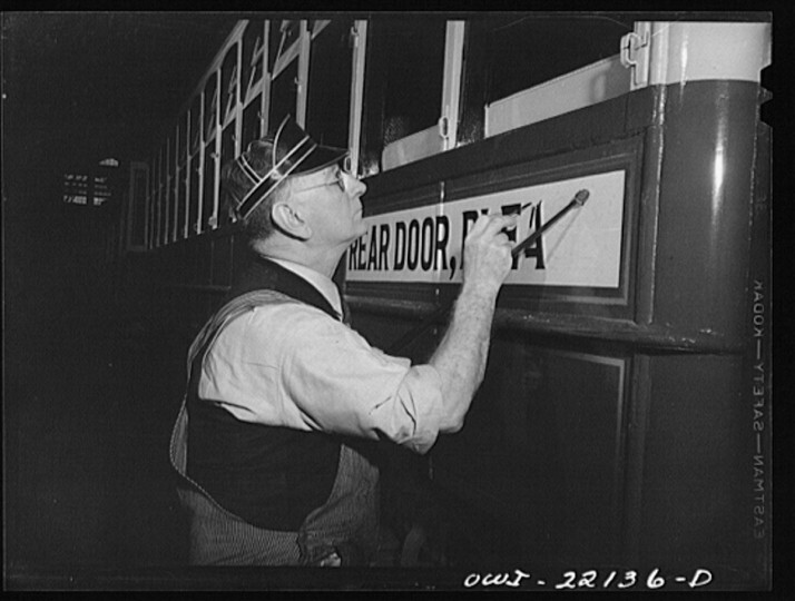 Baltimore, Maryland. Painting a sign on a trolley at the paint shop of the maintenance terminal of the Baltimore Transit Company. (Marjory Collins / April 1943)