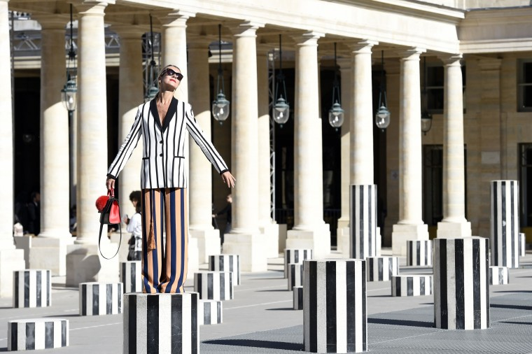 A guest poses before Isabel Marant's 2016 Spring/Summer ready-to-wear collection fashion show in Paris. (Miguel Medina/AFP Getty Images)