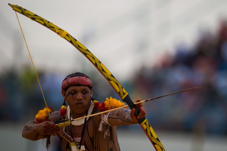 A Brazilian indigenous native participates in the archery competition of the first World Indigenous Games on October 25, 2015 in Palmas, Brazil. (Photo by Buda Mendes/Getty Images)