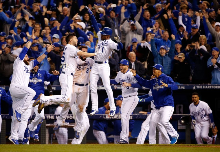 Eric Hosmer #35, Mike Moustakas #8 and Jarrod Dyson #1 of the Kansas City Royals celebrate the Royals 5-4 in 14 innings against the New York Mets during Game One of the 2015 World Series at Kauffman Stadium on October 27, 2015 in Kansas City, Missouri. (Photo by Sean M. Haffey/Getty Images)