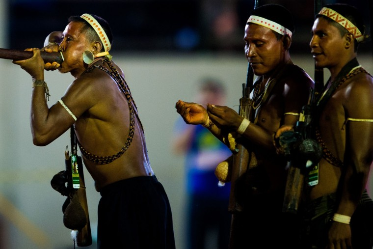 An indigenous man from the Matis tribe demonstrates the use of a blowpipe during the first World Games for Indigenous Peoples on October 27, 2015 in Palmas, Brazil. (Photo by Buda Mendes/Getty Images)