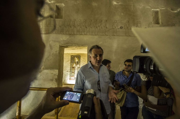 A picture taken on September 29, 2015 shows English Egyptologist Nicholas Reeves speaking to journalists during a visit to Horemheb tomb at the Valley of the Kings, close to Luxor, 500 kms south of Cairo. Standing before the majestic gold, ochre and white frescos of Tutankhamun's tomb, British archaeologist Nicholas Reeves passionately defended his daring theory that Nefertiti is buried in a secret chamber. (KHALED DESOUKI/AFP/Getty Images)