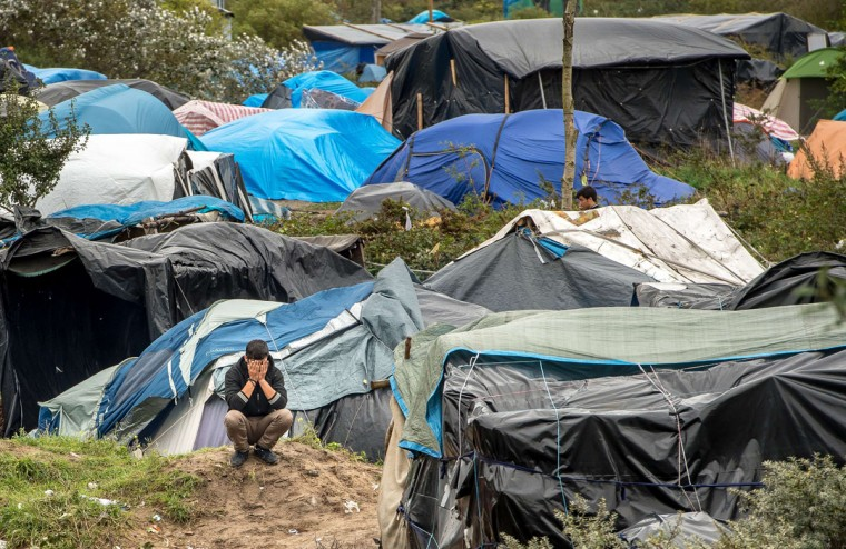 """A picture taken in Calais on October 7, 2015 shows a site dubbed the """"New Jungle,"""" where some 3,000 people have set up camp -- most seeking desperately to get to England. (PHILIPPE HUGUEN/AFP/Getty Images)"""