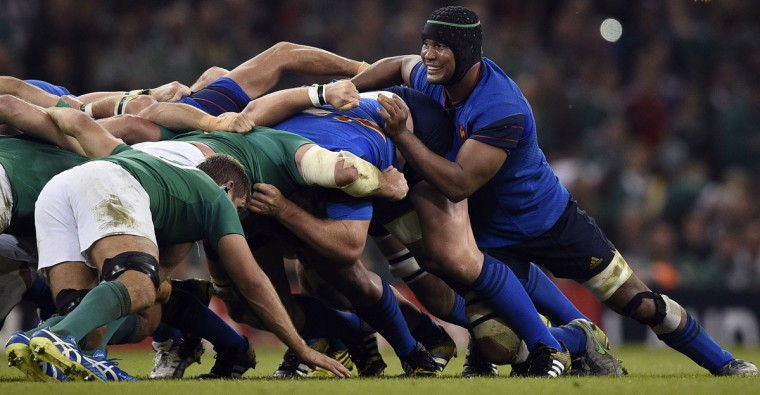 France's flanker and captain Thierry Dusautoir (R) pushes in a scrum during the Pool D match of the 2015 Rugby World Cup between France and Ireland at the Millennium Stadium in Cardiff, south Wales, on October 11, 2015. (AFP Photo/Franck Fife)