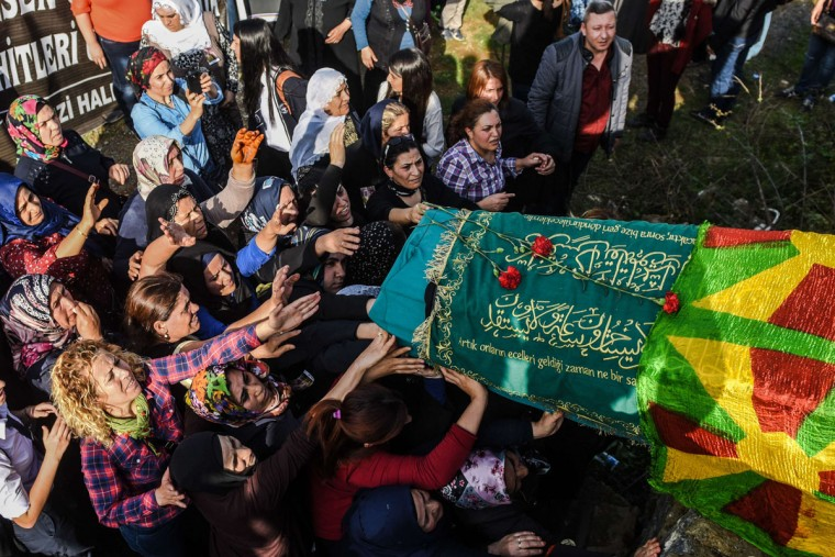 Women carry the coffin of Fatma Esen, one of the victims of the twin bombings in Ankara, during her funeral on October 12, 2015 in the Gazi distrit of Istanbul. Turkey mourned the killing of at least 95 people in twin suspected suicide bombings on a peace rally in Ankara on October 10, its worst ever attack that raised fears for the country's stability. Prime Minister declared three days of national mourning, with flags flying at half mast across the country, as questions grew over who might have planned such an attack. (AFP Photo/Ozan Kose)