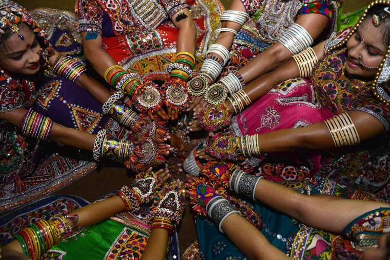 Indian folk dancers display ornaments during a break while participating in the first night of Navratri in Gandhinagar, some 30 km from Ahmedabad, on October 13, 2015. Navratri festivities, or Dance Festival of Nine Nights, takes place between October 13-21. (AFP Photo/Sam Panthaky)