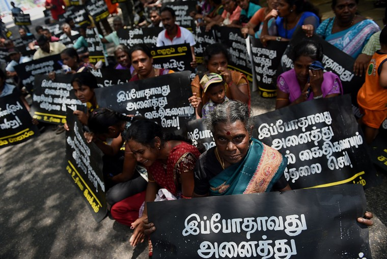Tamil protesters hold placards demanding the release of activists being held under tough anti-terror laws in the Sri Lankan capital Colombo on October 14, 2015. Hundreds of Tamils are said to be held in detention without trial for years despite the end of the islands drawn out Tamil separatist war in May 2009. (AFP Photo/ Ishara S. Kodikara)
