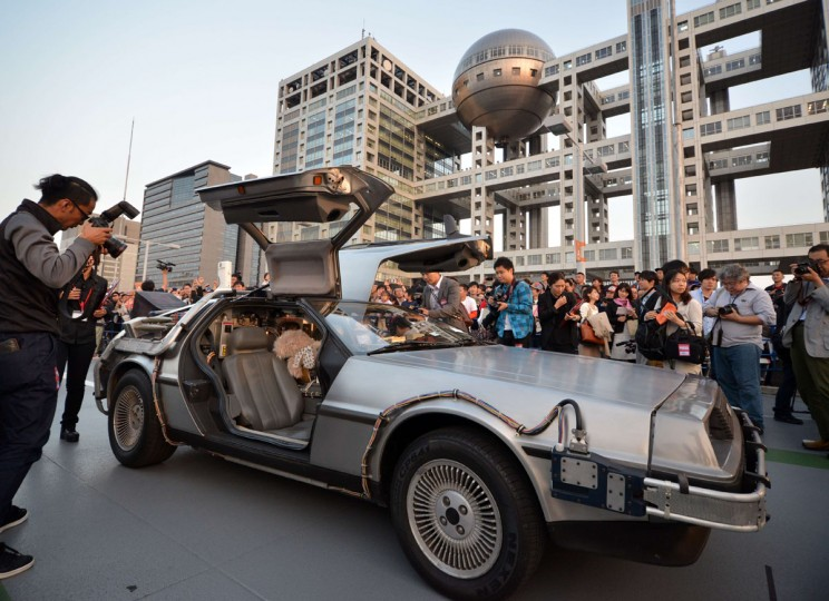 """A """"Back to the Future"""" style DeLorean, powered by methanol bio-fuel made from recycled clothing produced by a Japanese venture, is displayed before hundreds of movie fans on the rooftop of a shopping mall in Tokyo on October 21, 2015 for the 30th anniversary of the Hollywood movie """"Back to the Future"""". (AFP Photo/Yoshikazu Tsuno)"""