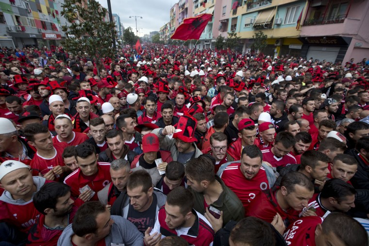 Albania fans wait to be searched by police before the Group I Euro 2016 qualifying match between Albania and Serbia in Elbasan, central Albania, Thursday, Oct. 8, 2015. More than 2,000 officers will police the politically-charged match. A game between the countries _ who remain at odds over the status of now-independent Kosovo _ was interrupted by violence in Belgrade last year after a drone carrying a nationalist Albanian banner hovered over the pitch. (AP Photo/Visar Kryeziu)